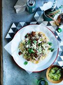 Oaxacan-style tlayudas tortillas with orn chips, pork belly and refried beans