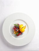 Mango sorbet with berries and icing sugar