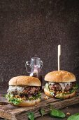Two hamburgers with beef burger cutlet, fried onion, spinach, ketchup sauce and blue cheese in traditional buns