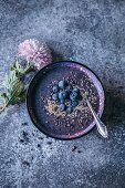 Blueberry acai banana smoothie bowl topped with bluberries, sesame seeds and cacao nibs