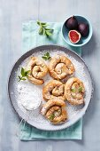Filo pastry buns with an almond and fig filling and orange blossom water