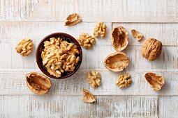 A whole walnut and walnut kernels