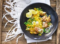 Paella with chicken and peas