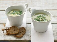 Poultry soup with egg, spinach and parmesan