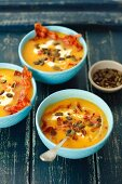 Pumpkin cream soup with caramelized bacon