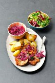 Pork schnitzel with caramelized onion and baked potatoes