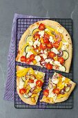 Vegetarian focaccia with pepper, courgette, onion, cherry tomatoes and feta