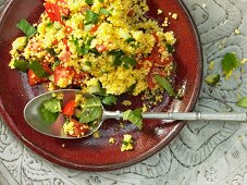 Millet salad with cucumber, tomatoes and mint