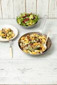 gnocchi fried with mushrooms, courgette and blue cheese