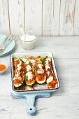 Courgette stuffed with beef and tomatoes with yogurt