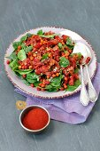 Spinach salad with baked bacon and chickpeas baked with garam masala