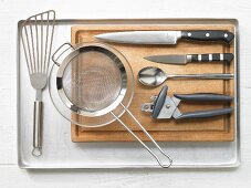 Kitchen utensils for making baked trout with salad