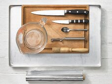 Kitchen utensils for making chicken with vegetables in foil