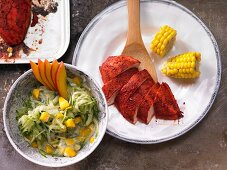 Indian chicken with corn and a mango and cucumber raita