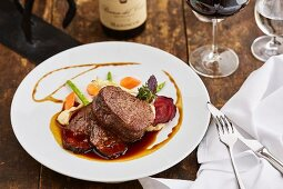 Fillet steak and ox on celery puree, served with red wine