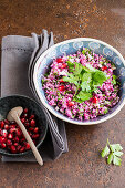 Purple cauliflower and pomegranate seed tabbouleh