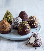 Cream kisses with coconut, chocolate, pistachios and walnuts