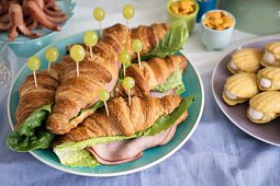 Savoury croissants with ham and grapes for a maritime themed party