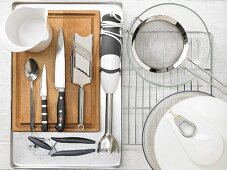 Kitchen utensils for making oven cooked tomatoes with tuna cream and salad