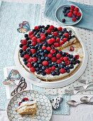 A layered cake with blueberries and raspberries (lactose and gluten-free)