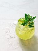 A cocktail with lime and mint