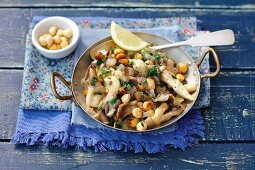Oyster mushrooms fried with hazelnuts and shallots