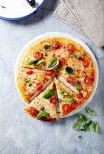Cheese pizza with cherry tomatoes and capers