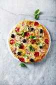 Pizza with chorizo, cheese and red onion
