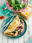 Sweet chilli chicken in coriander omelettes