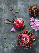 Berry desserts with flowers and mint
