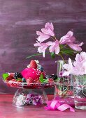 A birthday berry dessert in a hand-painted glass dish