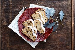 A sliced Christmas fruit loaf on a red plate