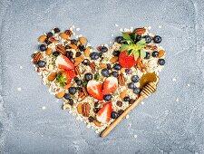 Ingredients for healthy breakfast: muesli in shape of heart
