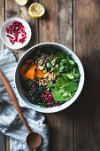 Kale salad with herbs, pomegranate, persimmon