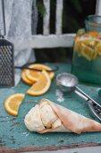 Homemade orange and vanilla ice cream served in a cone