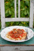 Pasta (tagliatelle) with tomato sauce and wild mushrooms (milk caps)