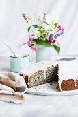 Piegusek (poppy seed cake, Poland) with a sugar glaze, sliced