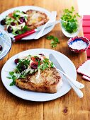 Pork chops with a cherry citrus salad