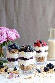 Chai latte granola with yogurt and berries in jars