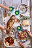Seared tuna and noodle salad, seafood bouillabaisse, whole baked fish with lemon and caperberry butter