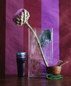Artichoke flower in glass vase