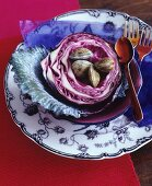 Venus mussels in a red cabbage