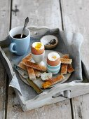 Soft-boiled dippy eggs with soldiers for breakfast