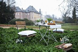 Set table in garden of manor house