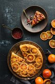 Upside-down cake with blood oranges and pomegranate syrup (seen from above)