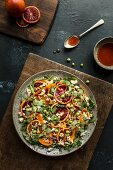 Blood orange salad with rocket, peas, carrots, feta and blood orange dressing