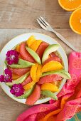 Avocado salad with orange and pink grapefruit wedges (seen from above)