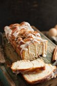 White yeast bread with cinnamon twisted inside and a powdered sugar glaze