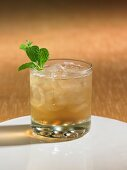 A ginger and vodka cocktail with mint leaves