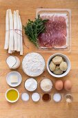 Ingredients for a white asparagus quiche with Parma ham and arugula